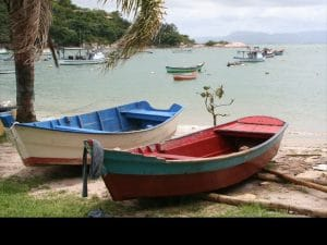 A nature hike takes guests past fishing boats of all sizes bobbing in the small bay below Ponta dos Ganchos.